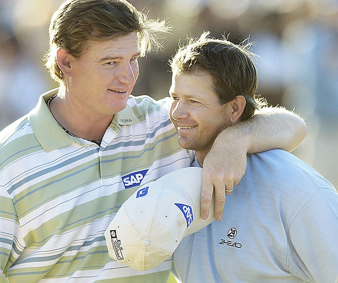 Retief Goosen is congratulated by fellow South African Ernie Els after Goosen won the 2004 U.S. Open at Shinnecock Hills Golf Club in Southampton, N.Y.