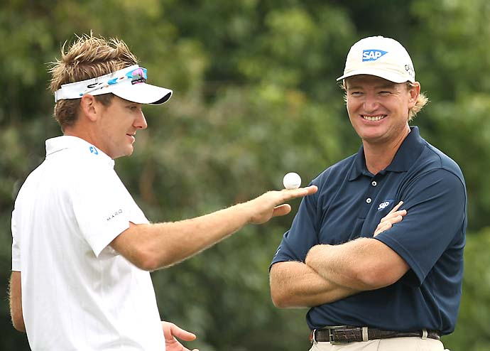 Ernie Els shares a joke with Ian Poulter during the third round of the 2009 HSBC Champions in Shanghai.