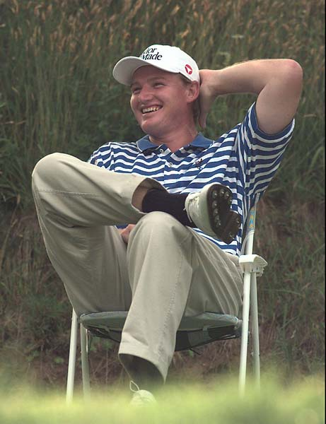 Ernie Els relaxes in a chair while waiting to tee off at the fifteenth green in the third round of the Buick Classic in Harrison, N.Y. Saturday, June 21, 1997.