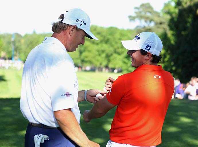 Rory McIlroy shares a joke with Ernie Els during the second round of the BMW PGA Championship on the West Course at Wentworth on May 25, 2012 in Virginia Water, England.