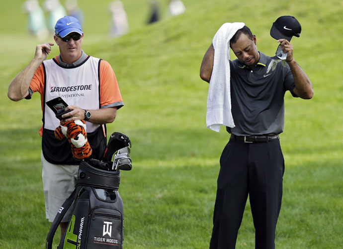 Tiger Woods cools off while waiting to his his approach shot to the 10th green. The defending WGC-Bridgestone champion, Tiger has won eight times at Firestone.