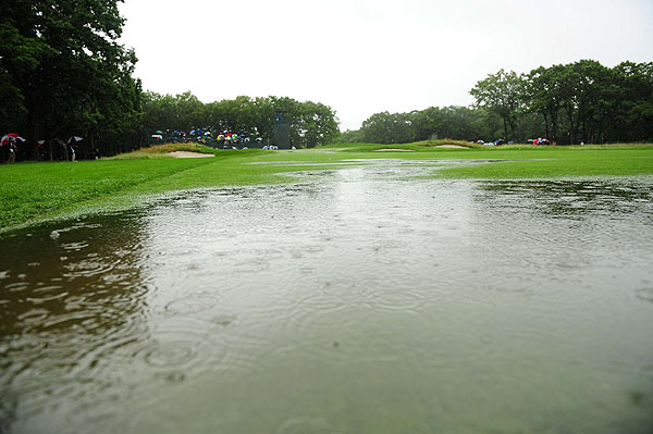 Note: This water hazard was not there when the tournament began Thursday morning.
