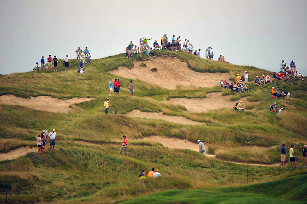 Spectators enjoyed spending time around the bunkers more than the players did on Friday.