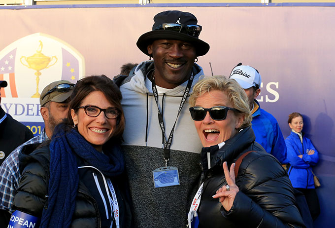 Michael Jordan isn't really dressed that well, but he's such a dedicated fan, we could not leave him out. He was on the tee at 7 a.m. this morning waiting for the opening tee shots.