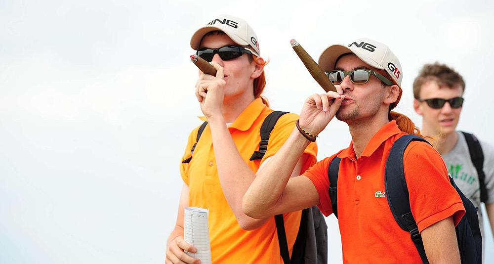 ... and smoke his trademark cigars.