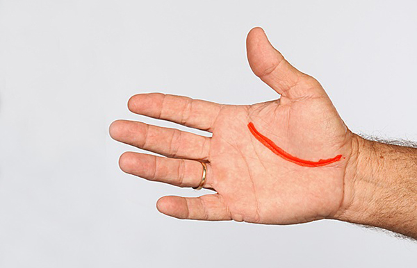 1. Grip the club with your left hand                       and hold it in front of your body.                       With your right hand flat, wrap                       the fingers of that hand under                       the grip so the lifeline rests                       along your left thumb. (I color                       the lifeline to help with                       alignment.)