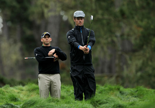 , right, with Sergio Garcia.
