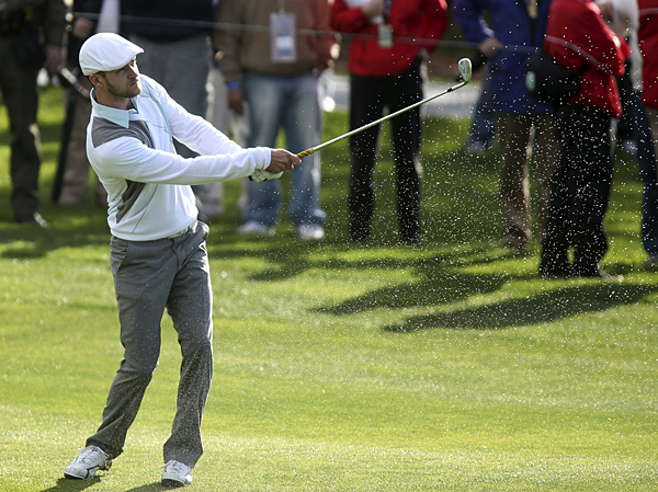 Justin Timberlake and partner Fred Couples combined to shoot a 2-under 70.