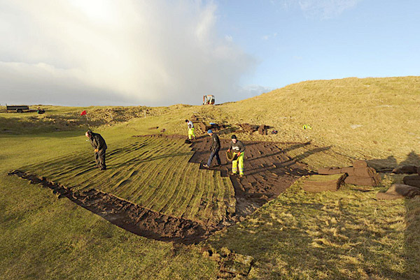 Paid with a grant from Bandon Dunes developer Mike Keiser, workers were hired to help cut and transplant turf, among other things.