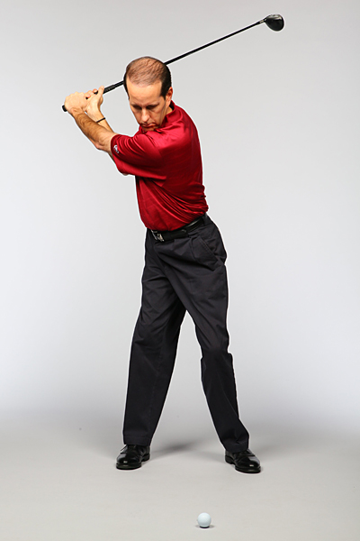 When your hands and body get out of sync, you'll have a timing problem. Fix it by taking a normal backswing and pausing at the top. Keeping your back to the target and your weight over your right leg, slowly swing down so the club stops just before the ball.