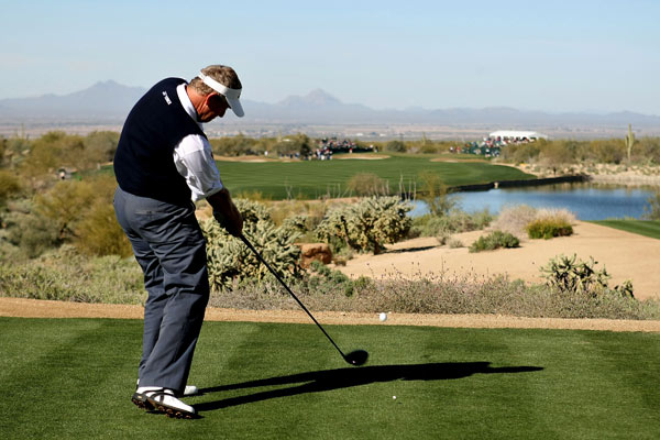 Colin Montgomerie advanced to the third round after a 1-up victory over Charles Howell III.
