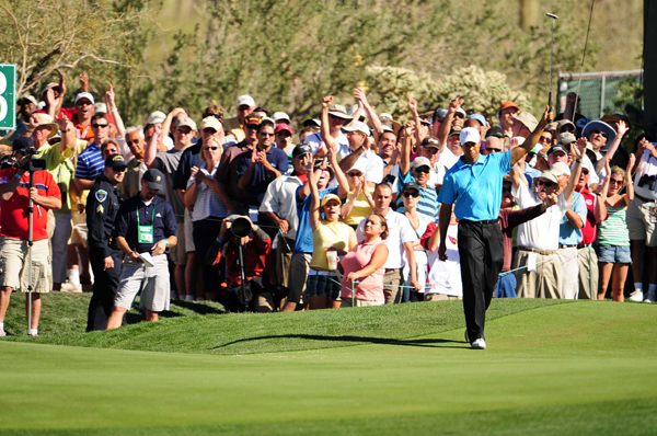 From just off the green on the par-5 13th, Woods drained a putt for eagle and a 4-up lead.