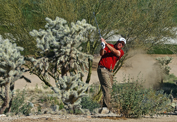 Mickelson had to dodge a patch of cactus on the second hole.