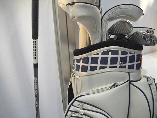 Fashion is everywhere. Ubiquitous! But this is the living end - coordinated clubs and golf bag. Here, for the woman golfer who really does have everything, is a custom cart bag with matching golf clubs (note the checked shaft detailing). The clubhead also has badges that match the bag. Sold with all-Adams clubs $1,100 (bag alone, $335) from Keri Golf.