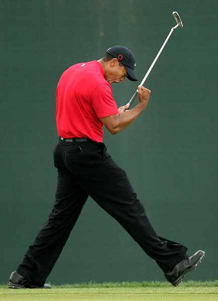 Woods birdied five of his last seven holes to win.