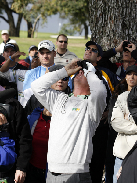 Hoffman tried to identify his golf ball with a fan's binoculars.