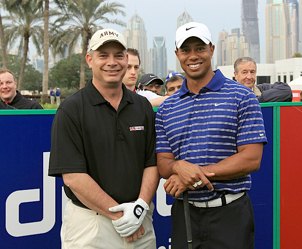 "Tiger Woods                       He tries to hide it, but Tiger (shown here at the Dubai Desert Classic with Lt. Col. Michael Rowells of the 401st United States Army Field Support Brigade) has always had a sense of humor, sharing fart jokes with David Feherty and checking into hotel rooms under the name ""Eric Cartman."" Here's a classic Tiger joke which Feherty recounted in the April 2006 issue of Golf Magazine:                                              Tiger: ""What do you call a black guy flying an airplane?""                        Feherty: ""Umm, I don't know.""                        Tiger: ""A pilot, you f---ing racist."""