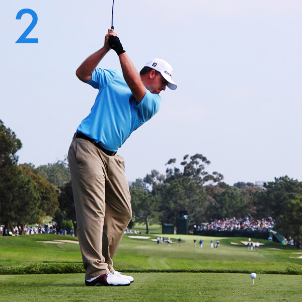 2. Notice the change in J.B.'s posture. He has straightened his legs and lifted his arms almost straight up. Most instructors would change these positions, but they create width in his swing. He gets even more power by coiling hard against his lower body (see how little his hips have turned).