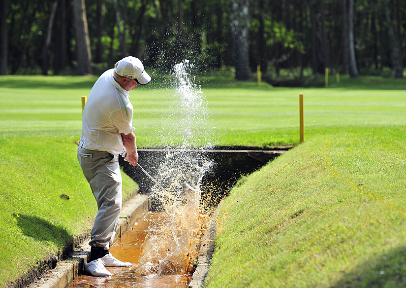 Richard Finch unsuccessfully tried to play a shot from the water on No. 12.