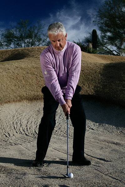 How to Escape Any Bunker, Any Time                      Focus on your weight shift — not your swing — to blast sand shots close                                           By Bill Forrest                      Top 100 Teacher                                                               This story is for you if...                                          • You've been playing the game for years and still don't know how to get out of bunkers.                                          • You don't know whether you should open your club or your stance in the sand.                                          The Problem                                          You struggle with sand shots, despite hours spent learning and practicing different techniques.                                          Why It's Happening                                          The problem is information overload. Over the years you've been told to open your stance, stand square to the ball, weaken your grip, keep your normal grip, open the face, keep the leading edge square, etc. The truth is, you can execute successful bunker shots doing any of these things.                                          The Solution                                          Regardless of any move you make in your bunker swing, you must start with your weight left, and rotate more weight to the left. When you swing like this your club automatically bottoms out in the center of your stance. Now you can adjust the ball position based on the sand. If you're in soft, heavy sand, move the ball forward in your stance four inches to splash out a lot of sand with the ball. But if you're on wet, hard sand, keep the ball in the center and hit it and the ground at the same time. Always hit the sand first with the bounce of the club, not the leading edge.                                          ADDRESS Start with about 55 percent of your weight on your left side.