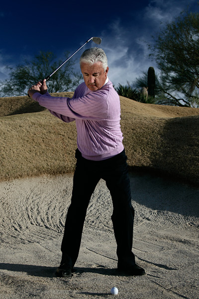 BACKSWING As you swing the club back, keep that weight over your left side. No shifting or swaying!