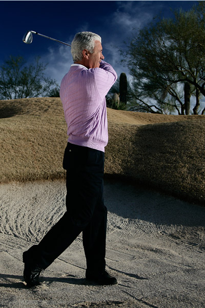 FINISH At the end of your swing, all of your weight should be on your left side.
