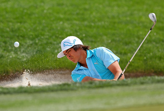 Rickie Fowler finished with a birdie and an eagle to move back into contention.