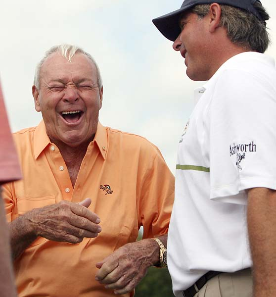 Fred Couples and Arnold Palmer share a laugh together on the practice range during the third round of the Arnold Palmer Invitational at the Bay Hill Club and Lodge in Orlando, Fla., on March 15, 2008.
