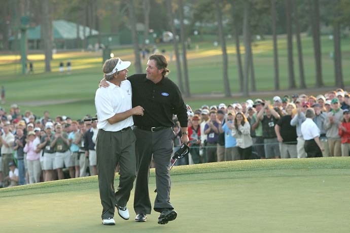 Fred Couples congratulates Phil Mickelson after Mickelson wins the 2006 Masters. Couples finished T3.