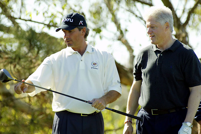 Former President Bill Clinton and Fred Couples examine a driver during the pro-am of the Hyundai Matches at Monarch Beach Golf Links on Nov. 15, 2002 in Dana Point, Calif.