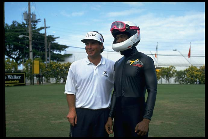 Fred Couples with an Olympic Jamaican bobsledder at the Johnnie Walker Classic in Thailand in December 1994.