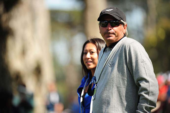 Fred Couples wears a media badge as he watches the 2012 U.S. Open as a fan at San Francisco's Olympic Club.