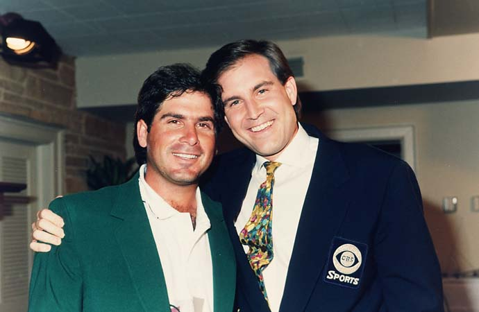 Fred Couples poses with his University of Houston roommate, CBS Sports announcer Jim Nantz, in Butler Cabin after Couples won the 1992 Masters.