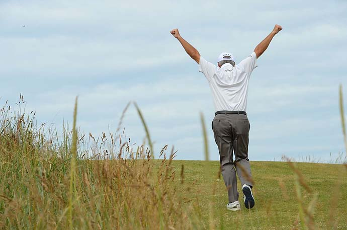 Fred Couples stretches his back during the first round of the 2013 British Open at Muirfield.