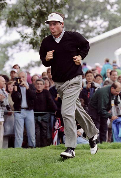 Fred Couples runs to catch up with his foursome on the tenth hole during a Ryder Cup practice round at Oak Hill Country Club in September 1995.