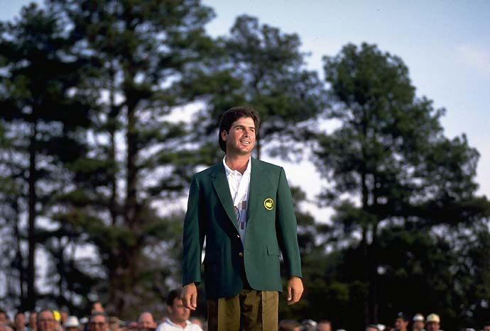Fred Couples wears his green jacket amid the tall pines after winning the 1992 Masters.