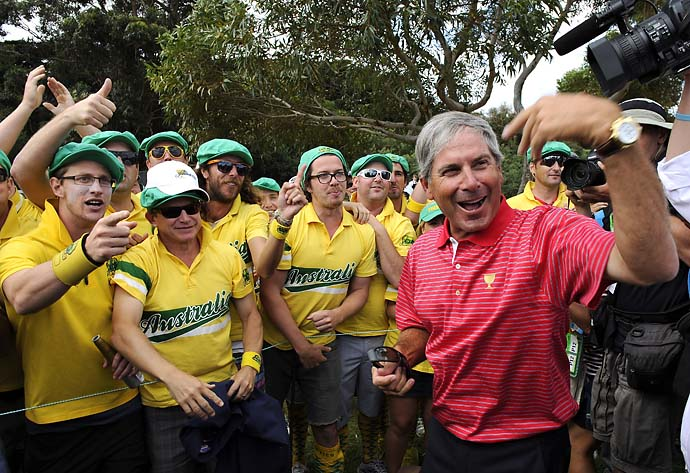 U.S. team captain Fred Couples celebrates with Aussie fans on the 17th hole after the Day Four Singles Matches of the 2011 Presidents Cup at Royal Melbourne Golf Course on Nov. 20, 2011.
