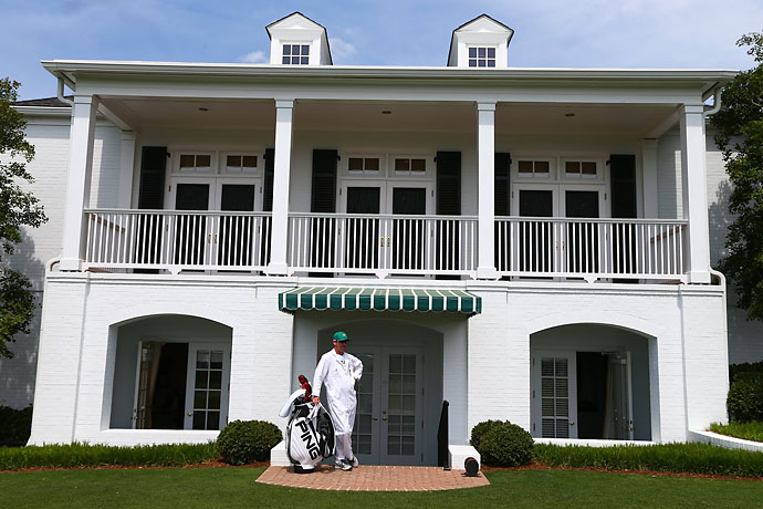 A caddie waits for his player outside the Augusta National clubhouse on Friday.