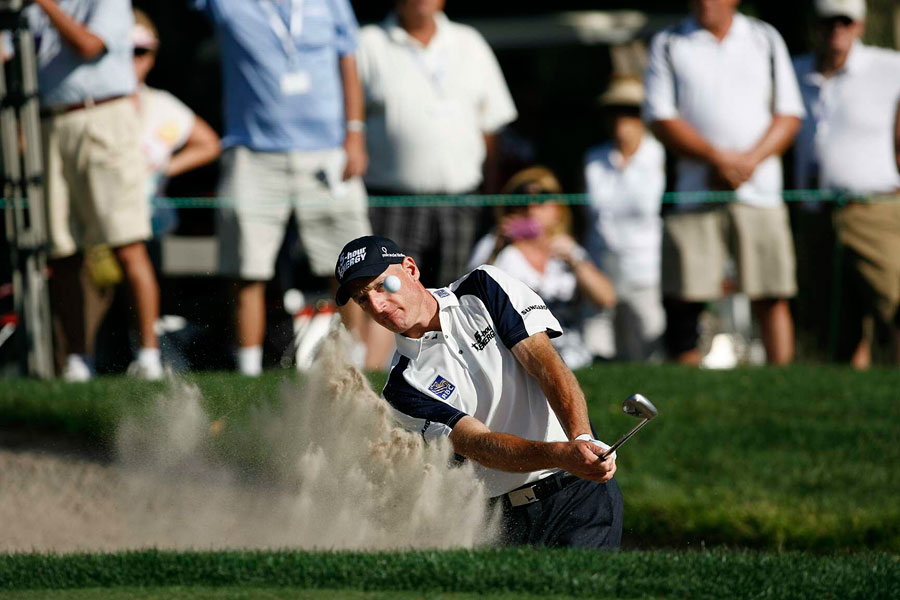 Jim Furyk bogeyed 18 to drop back into a share of the lead with Retief Goosen.