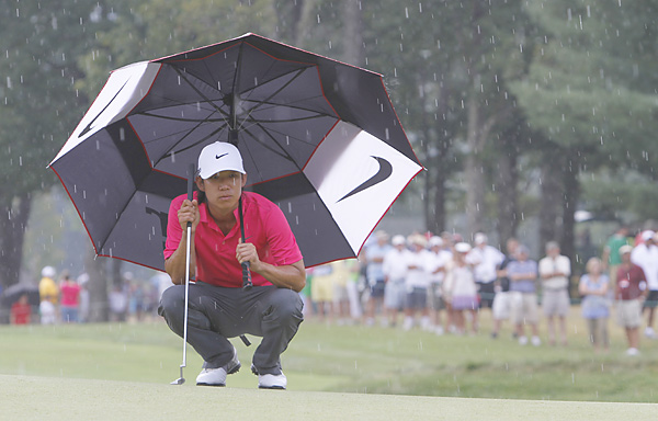 The pros had to play through a brief shower on Sunday afternoon.