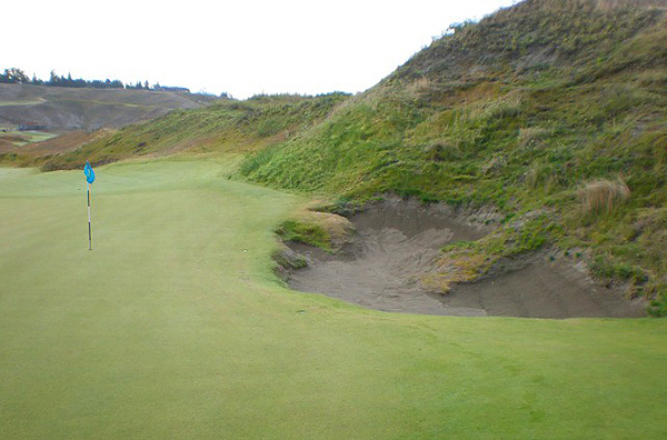Great care was taken to create natural craggy edged greenside bunkers that may claim a misplayed shot.  The hard, tight turf portion of the green spills into the bunker.  In Championship conditions, the greens are concrete hard and the ball does not leave any pitch mark when it lands.