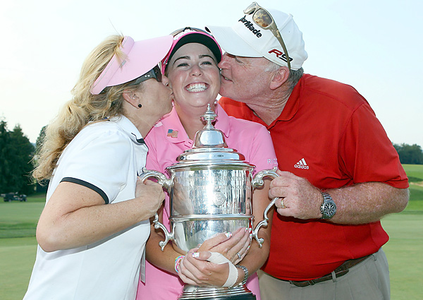 celebrated her first career major title with her mom, Karen, and dad, Paul.