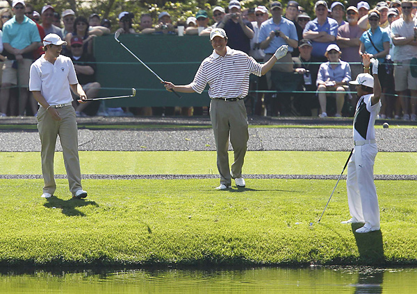 Peter Uihlein (left), Nathan Smith (center) and Rickie Fowler had some fun while skipping balls across the pond on the par-3 16th hole.