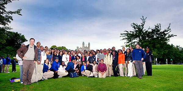 Doak (far left in brown pants) and his design associate Brian Slawnik (far right in blue fleece) pose with a grateful group of Midnight Golfers. Slawnik, a Detroit native, oversaw construction of the project.