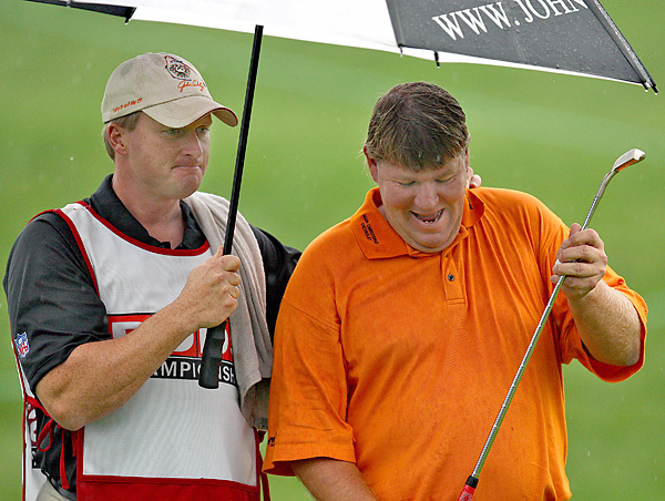 John Gruden, then coach of the Tampa Bay Buccaneers, looped for John Daly for seven holes after a rain delay at the 2008 PODS Championship.