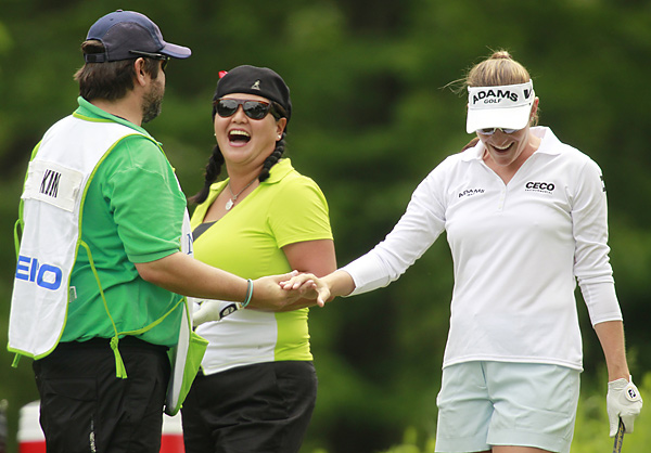Brittany Lang celebrated with Christina Kim and Kim's caddie Dan Chapman after Lang hit a hole-in-one on the eighth hole. Lang went on to beat Kim 5 and 4.