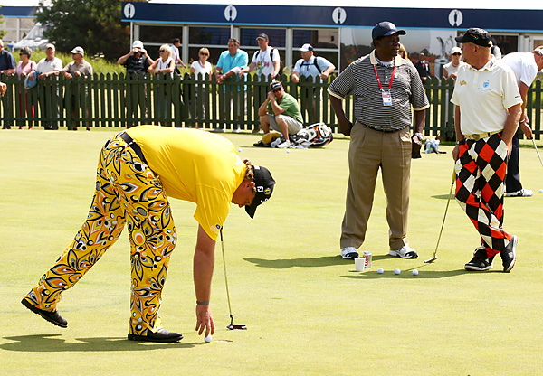 For once, John Daly (right) wasn't the most loudly dressed player on the practice green. That honor went to Australia's Kurt Barnes.