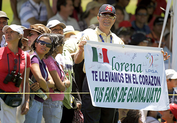 """fans came out in force. This sign reads in Spanish, """"Lorena, we carry you in our hearts. Your fans from Guanajuato"""""""