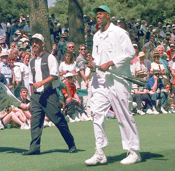 The annual Par 3 Contest at the Masters has produced several unique caddie cameos, including David Robinson looping for Corey Pavin here in 1997.