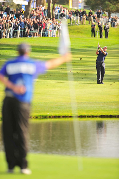 Mickelson need to eagle the 72nd hole to force a playoff with Watson. He had his caddie, Bones MacKay, tend the pin as Mickelson attempted a 72-yard wedge shot. The ball settled about three feet from the pin.